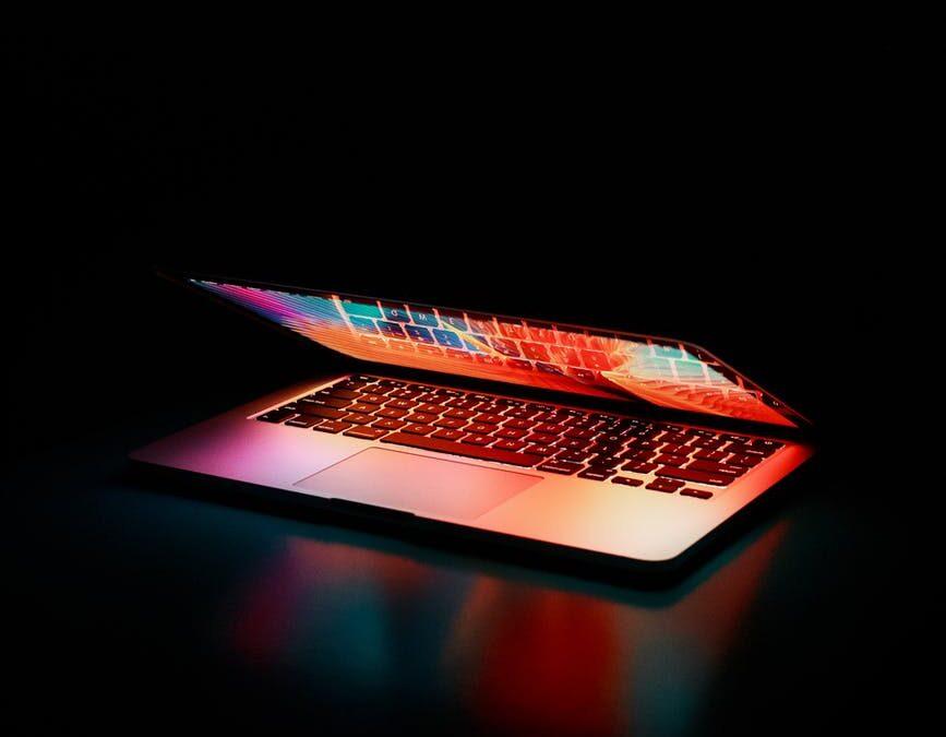 semi opened laptop computer turned on on table